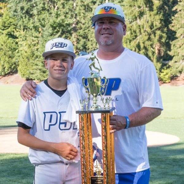 Josh Polacek with his son. JP also has a passion for helping young sports players reach their potential.